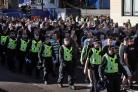Police attend a Republican march in Glasgow