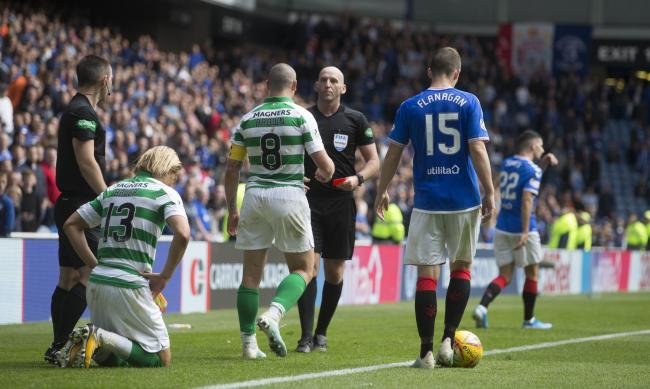 Rangers winger Jordan Jones, back right, after being sent off by referee Bobby Madden during the Scottish Premiership Old Firm match at Ibrox