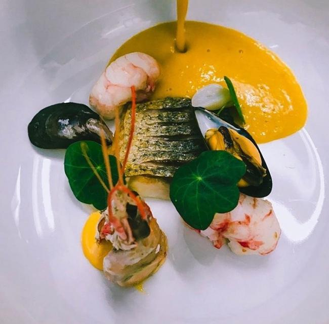Fennel and orange soup with seafood