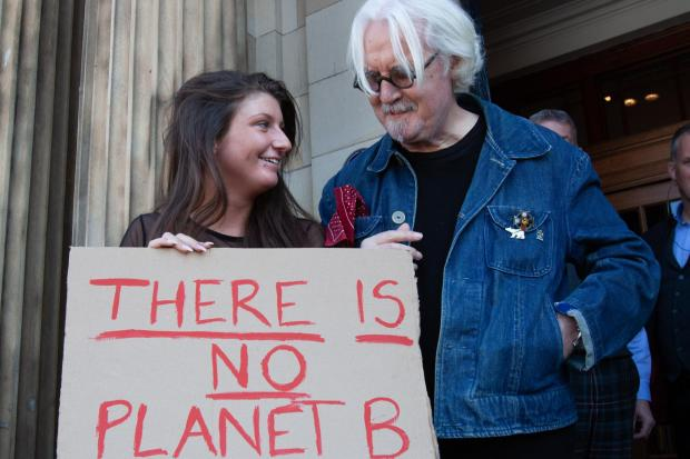 Billy Connolly on the steps of the Blythswood Square Hotel as marchers walk past. Photograph by Colin Mearns.