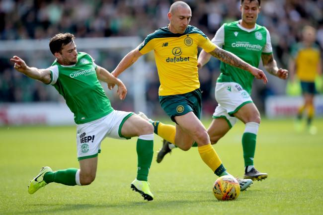 Celtic captain Scott Brown, right, in action against Hibernian. Picture: Jane Barlow/PA Wire.
