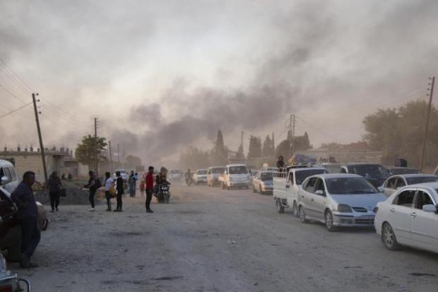 The National: Syrians flee shelling by Turkish forces in Ras al Ayn yesterday
