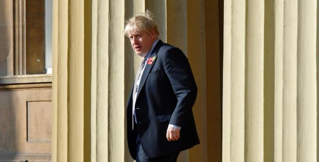 Prime Minister Boris Johnson leaves Buckingham Palace in London after an audience with Queen Elizabeth II ahead of the formal start of the General Election