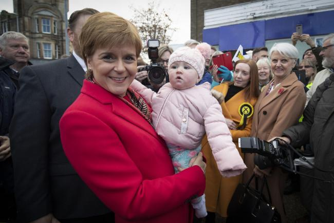 SNP leader Nicola Sturgeon (left) meets 10-months old Mya Quinn during a visit to the One Dalkeith Community Hub