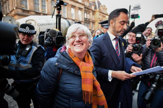 Clara Ponsati and her lawyer Aamer Anwar depart the Sheriff Court after she was released on bail