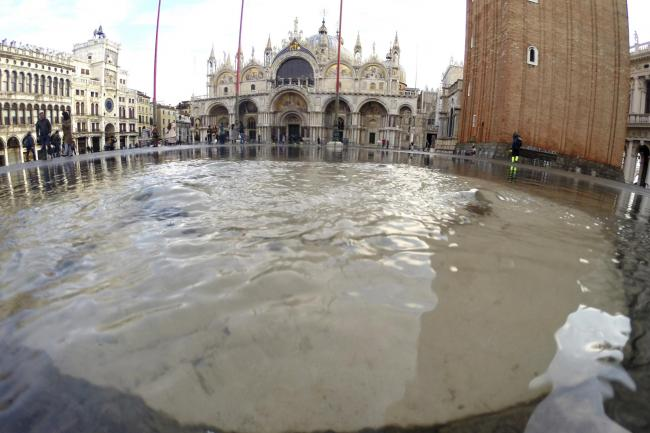 Water starts rising again in St. Mark square in Venice, Italy