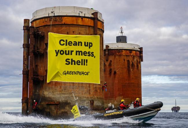 Greenpeace activists from the Netherlands, Germany and Denmark after they boarded two oil platforms in Shell's Brent field off the coast of Lerwick, Shetland