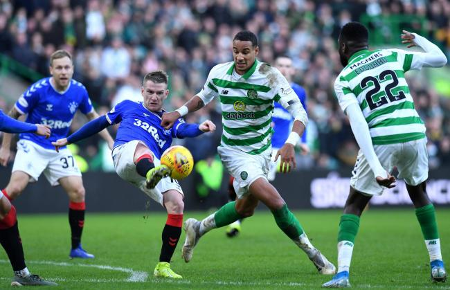 Steven Davis of Rangers, centre left, and Christopher Jullien of Celtic challenge for the ball back in December. Photo: Mark Runnacles/Getty Images.