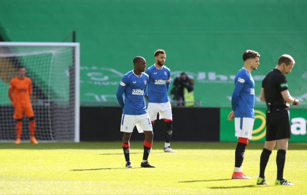 The National: Glen Kamara (l) and team mates take a stand pre match rather than taking a knee before the Ladbrokes Scottish Premiership match between Celtic and Rangers at Celtic Park