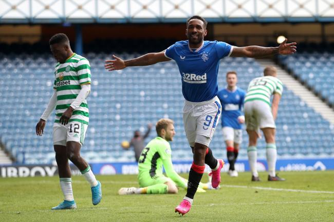 Jermain Defoe scores Rangers' fourth as Celtic players look dismayed.