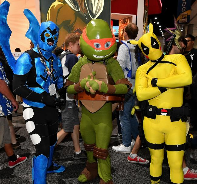 Cos-players show off their outfits at this year's San Diego Comic-Con   Photograph: Getty