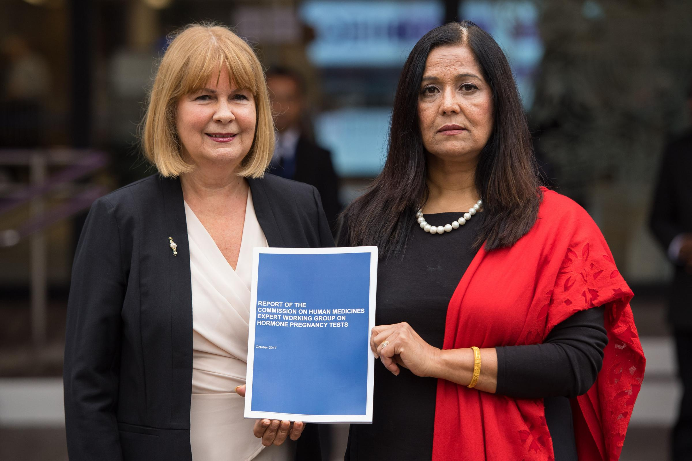 From left, Chair of the Association for Children Damaged by Hormone Pregnancy Tests Marie Lyon and Yasmin Qureshi MP hold a copy of the Commission on Human Medicines Expert Working Group Report on Hormone Pregnancy Tests .Picture by Dominic Lipinski/PA Wi