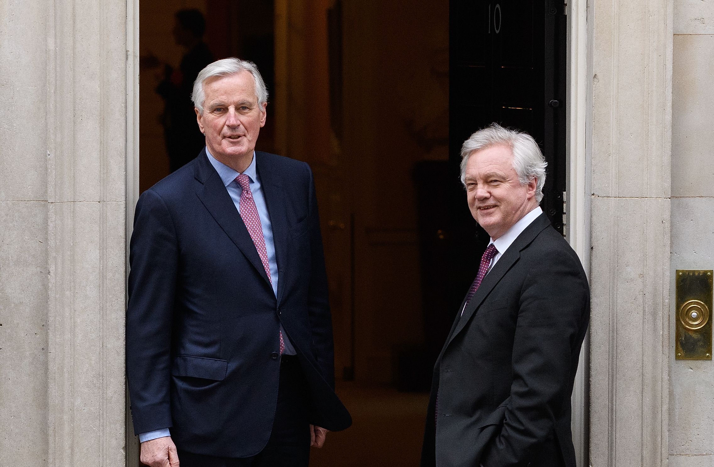 Michel Barnier (left) spoke of single market trade barriers but David Davis insisted Britain's position is 'perfectly clear'