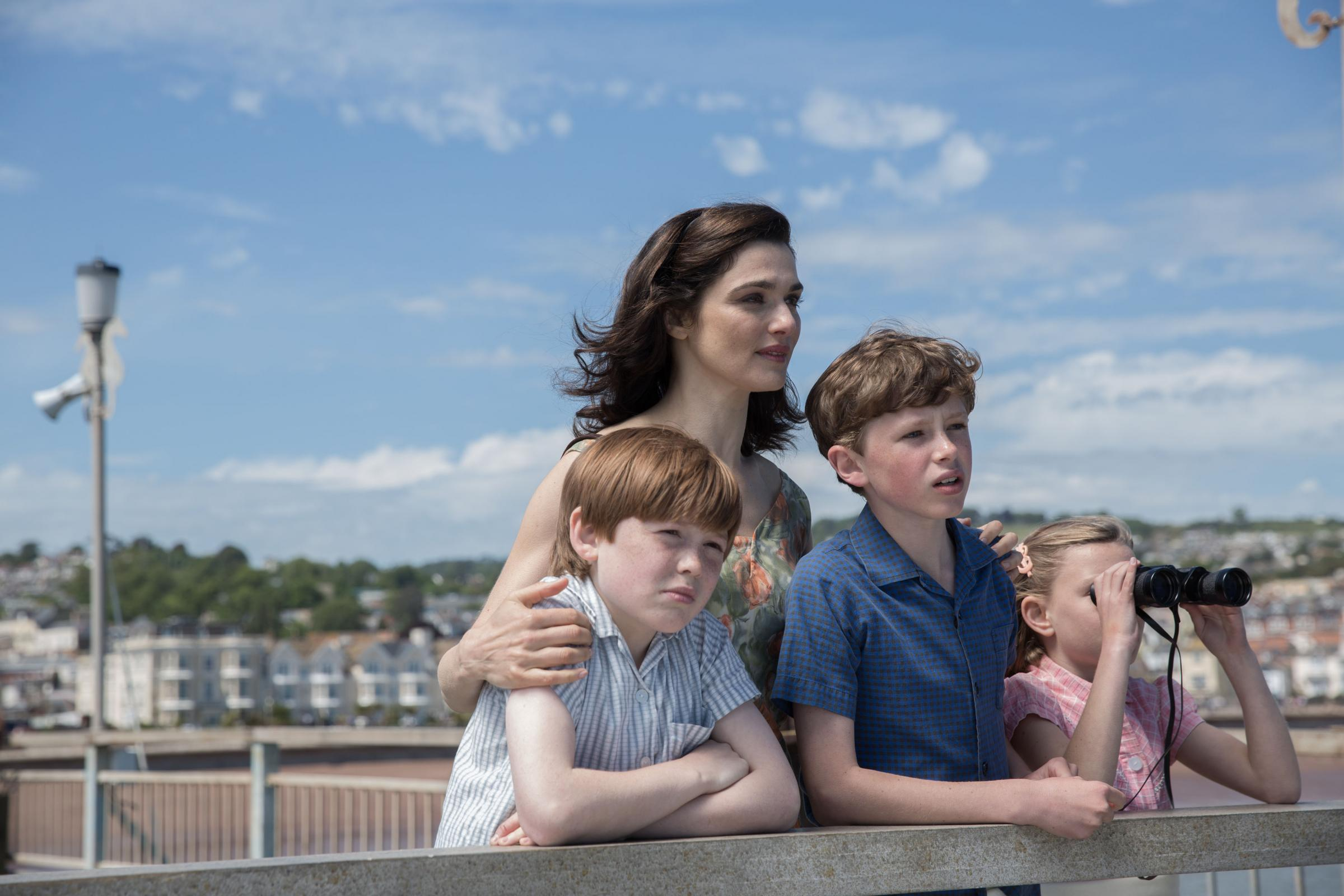 From left: Kit Connor as Roger Crowhurst, Rachel Weisz as Clare Crowhurst, Finn Elliot as James Crowhurst and Eleanor Stagg as Rachel Crowhurst