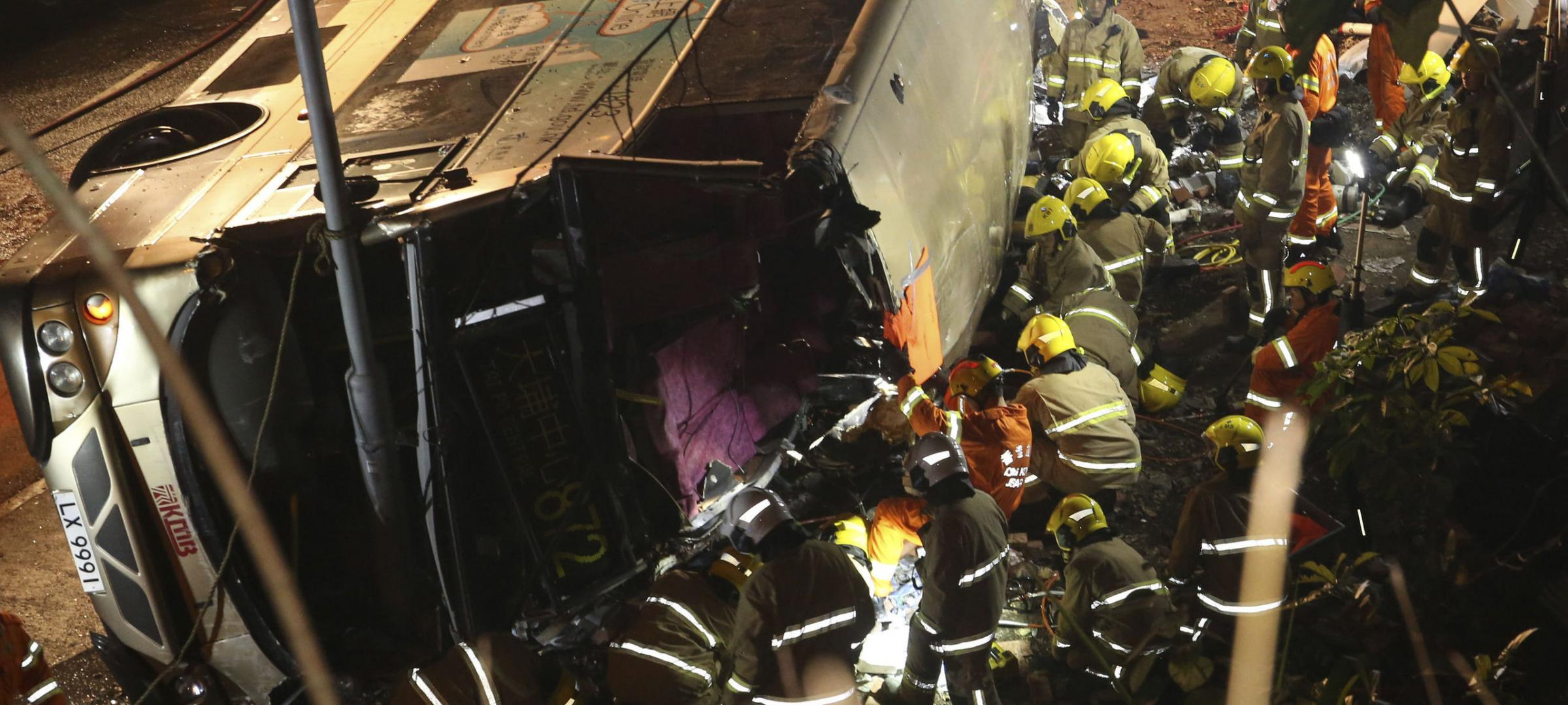 A double-decker bus lost control and crashed in a Hong Kong suburb on Saturday evening. Photograph: AP