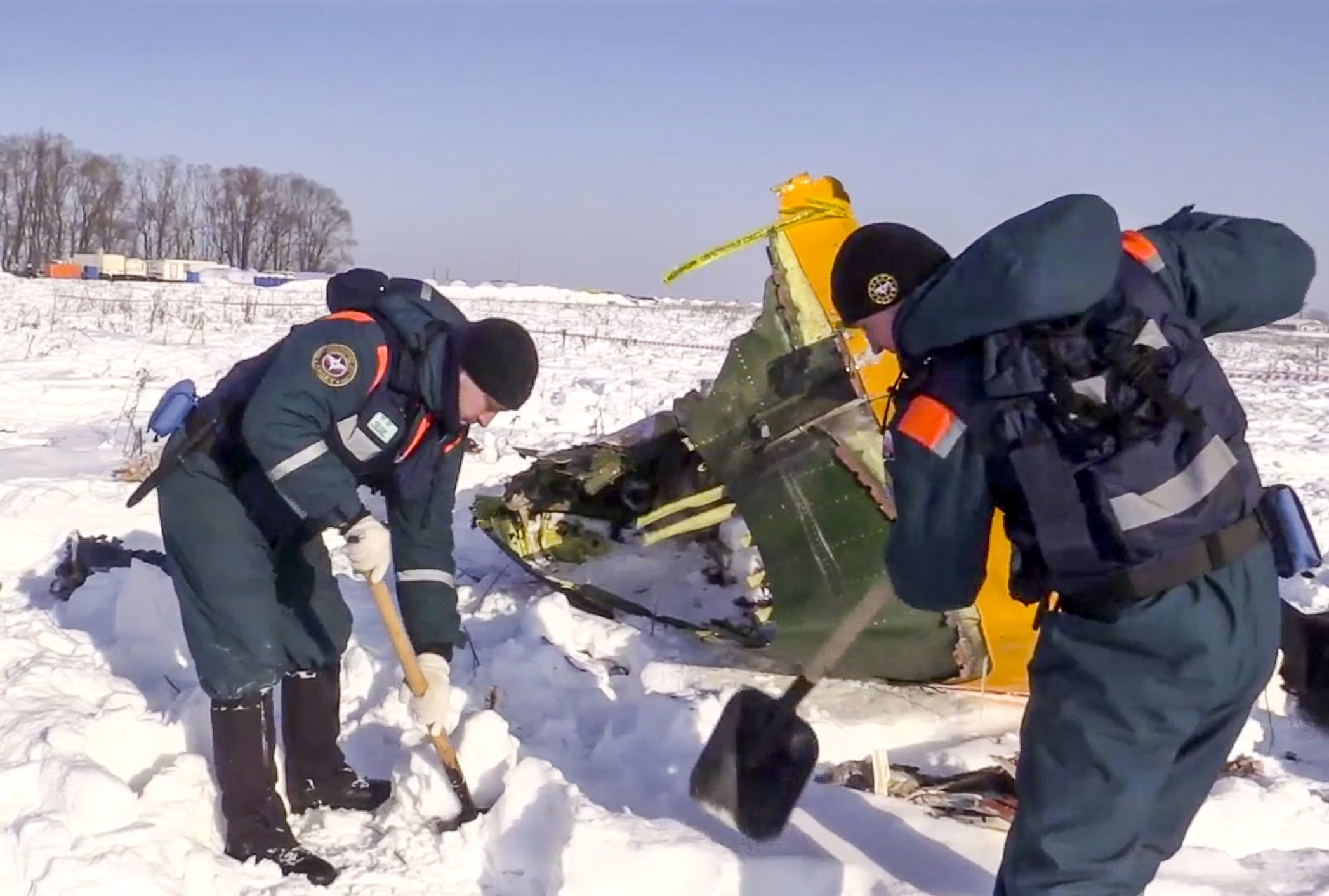 An emergency team working at the scene of the AN-148 plane crash