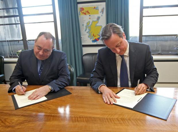 The National: Alex Salmond and David Cameron signing the Edinburgh Agreement on October 15, 2012 at St Andrew's House.