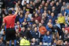 Dundee striker Kenny Miller , right, is shown a red card by referee Kevin Clancy, left.