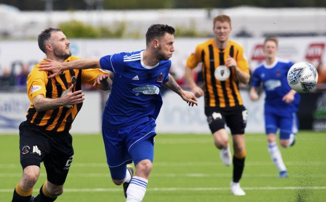 Berwick Rangers' Darryn Kelly (L) competes with Cove Rangers Mitchel Megginson in the first leg of their playoff tie