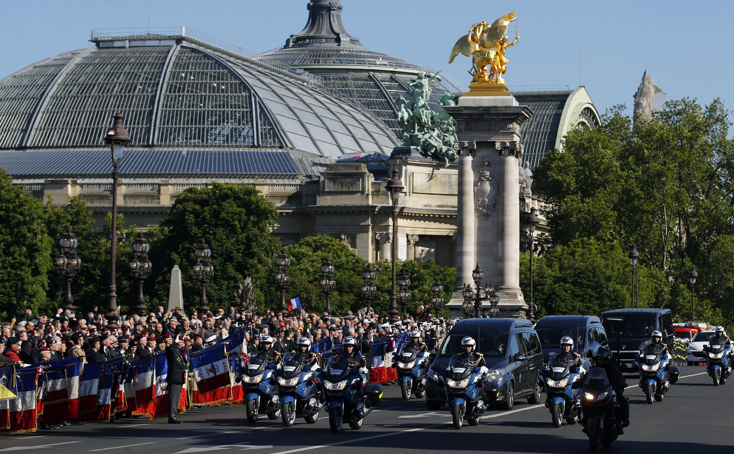 Crowds lined the Alexander III Bridge in Paris as the funeral cortege carrying the coffins of the two Marine commandos drove past