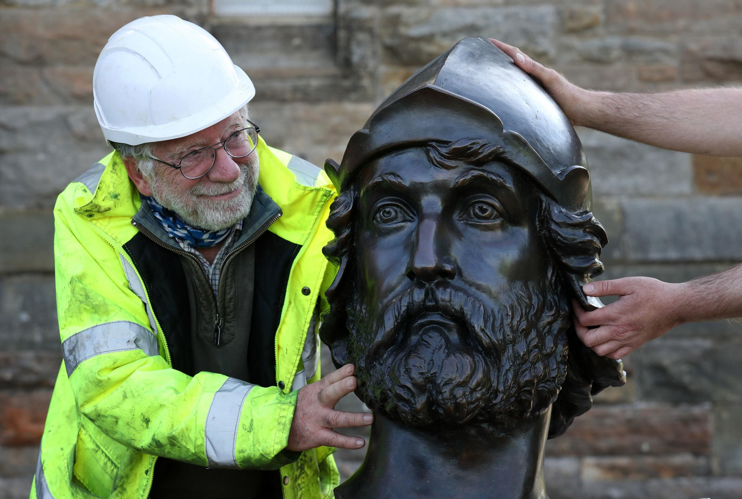 Conservator Restorer Jim Mitchell with part of the bronze statue of William Wallace which is being returned to the National Monument in Stirling after undergoing vital restoration work.
