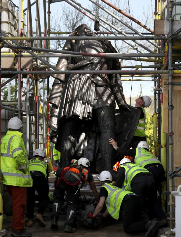 The National: Part of the bronze statue of William Wallace being hoisted into position, it is being returned to the National Monument in Stirling after undergoing vital restoration work.