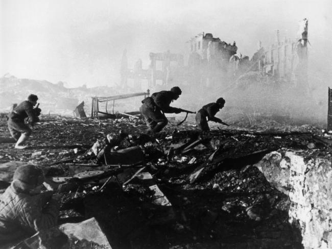 Red Army troops storming an apartment block amidst the ruins of Stalingrad during World War Two